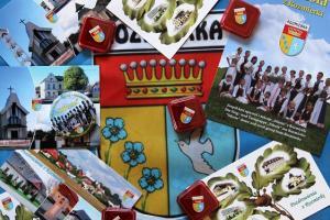 Broszura i buton Silesii, pocztówka, herb i flaga Rozmierki